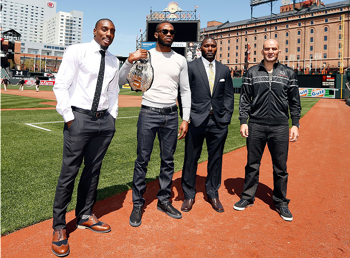BALTIMORE, MD - APRIL 24:  (L-R) Phil Davis, Jon Jones, Anthony Johnson, and Glover Teixeira pose for photos on the field at Camden Yards on April 24, 2014 in Baltimore, Maryland. (Photo by Josh Hedges/Zuffa LLC/Zuffa LLC via Getty Images)