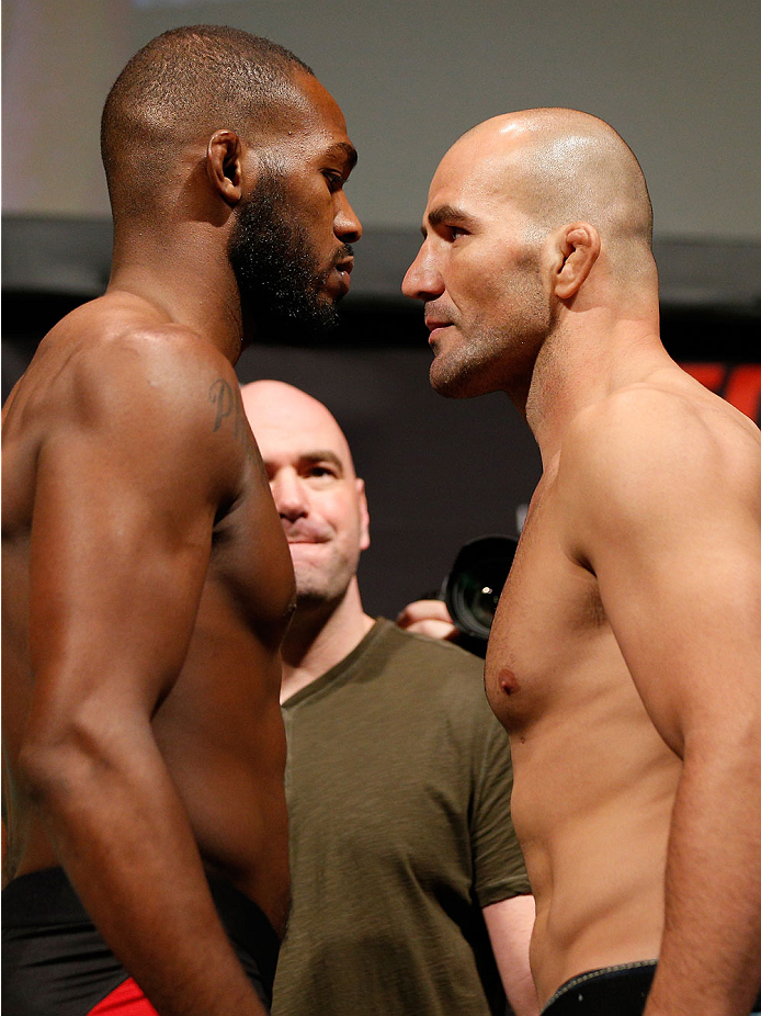 "BALTIMORE, MD - APRIL 25:  (L-R) Opponents Jon ""Bones"" Jones and Glover Teixeira face off during the UFC 172 weigh-in at the Baltimore Arena on April 25, 2014 in Baltimore, Maryland. (Photo by Josh Hedges/Zuffa LLC/Zuffa LLC via Getty Images)"