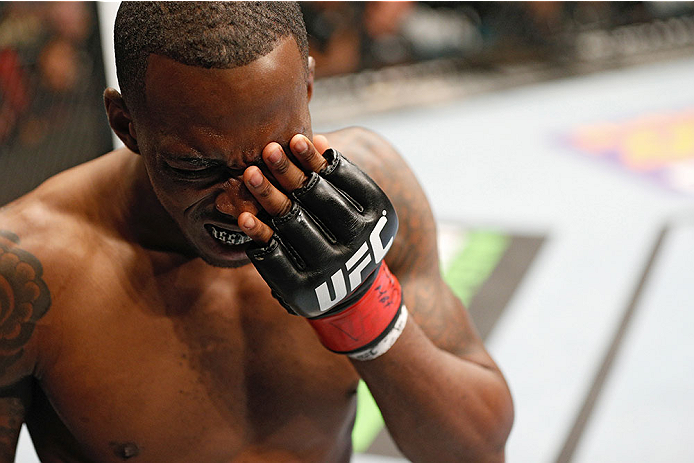 LAS VEGAS, NV - MAY 24:  Anthony Njokuani reacts to an accidental eye poke by Vinc Pichel in their lightweight bout during the UFC 173 event at the MGM Grand Garden Arena on May 24, 2014 in Las Vegas, Nevada. (Photo by Josh Hedges/Zuffa LLC/Zuffa LLC via Getty Images)