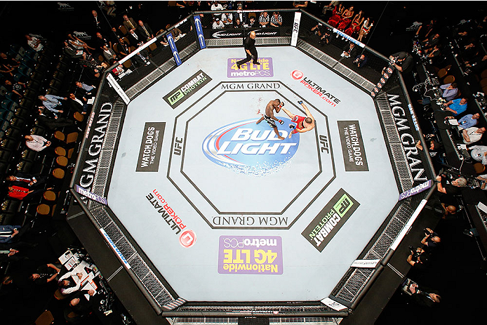 LAS VEGAS, NV - MAY 24:  An overhead view of the Octagon while Vinc Pichel (red shorts) kicks Anthony Njokuani during the UFC 173 event at the MGM Grand Garden Arena on May 24, 2014 in Las Vegas, Nevada. (Photo by Josh Hedges/Zuffa LLC/Zuffa LLC via Getty Images)