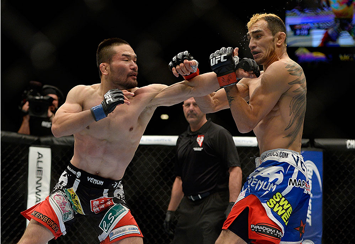 LAS VEGAS, NV - MAY 24:  (L-R) Katsunori Kikuno punches Tony Ferguson in their lightweight bout during the UFC 173 event at the MGM Grand Garden Arena on May 24, 2014 in Las Vegas, Nevada. (Photo by Jeff Bottari/Zuffa LLC/Zuffa LLC via Getty Images)