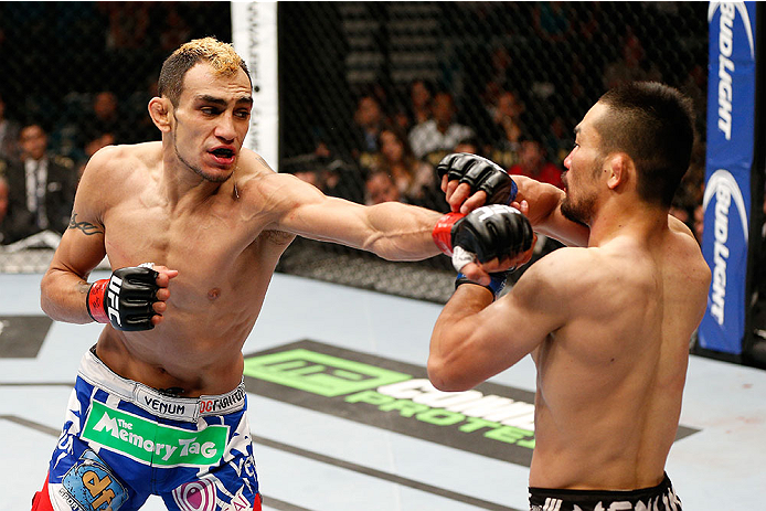 LAS VEGAS, NV - MAY 24:  (L-R) Tony Ferguson punches Katsunori Kikuno in their lightweight bout during the UFC 173 event at the MGM Grand Garden Arena on May 24, 2014 in Las Vegas, Nevada. (Photo by Josh Hedges/Zuffa LLC/Zuffa LLC via Getty Images)