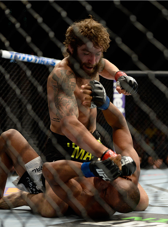 LAS VEGAS, NV - MAY 24: (L-R) Michael Chiesa elbows and controls the body of Francisco Trinaldo in their lightweight bout during the UFC 173 event at the MGM Grand Garden Arena on May 24, 2014 in Las Vegas, Nevada. (Photo by Jeff Bottari/Zuffa LLC/Zuffa LLC via Getty Images)