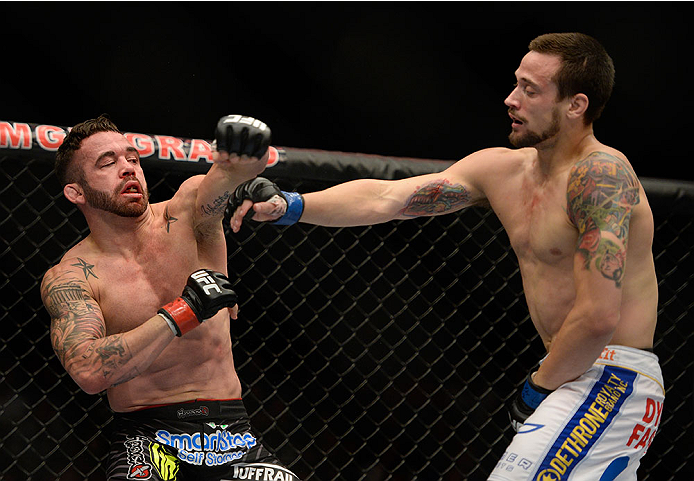 LAS VEGAS, NV - MAY 24:  (R-L) James Krause punches Jamie Varner in their lightweight bout during the UFC 173 event at the MGM Grand Garden Arena on May 24, 2014 in Las Vegas, Nevada. (Photo by Jeff Bottari/Zuffa LLC/Zuffa LLC via Getty Images)