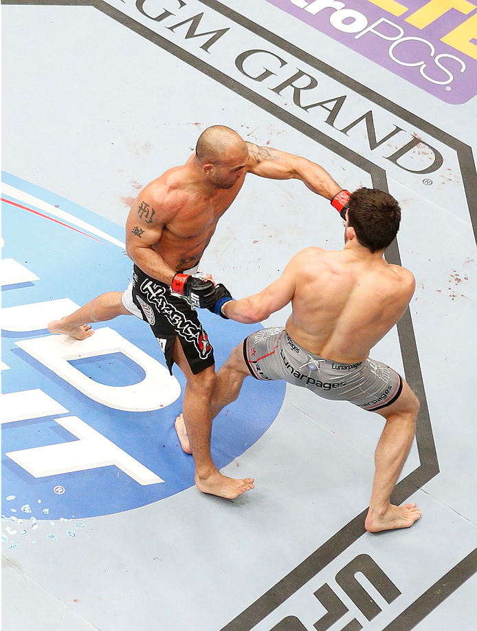 LAS VEGAS, NV - MAY 24:  An overhead view of the Octagon as Robbie Lawler (left) punches Jake Ellenberger during the UFC 173 event at the MGM Grand Garden Arena on May 24, 2014 in Las Vegas, Nevada. (Photo by Josh Hedges/Zuffa LLC/Zuffa LLC via Getty Images)