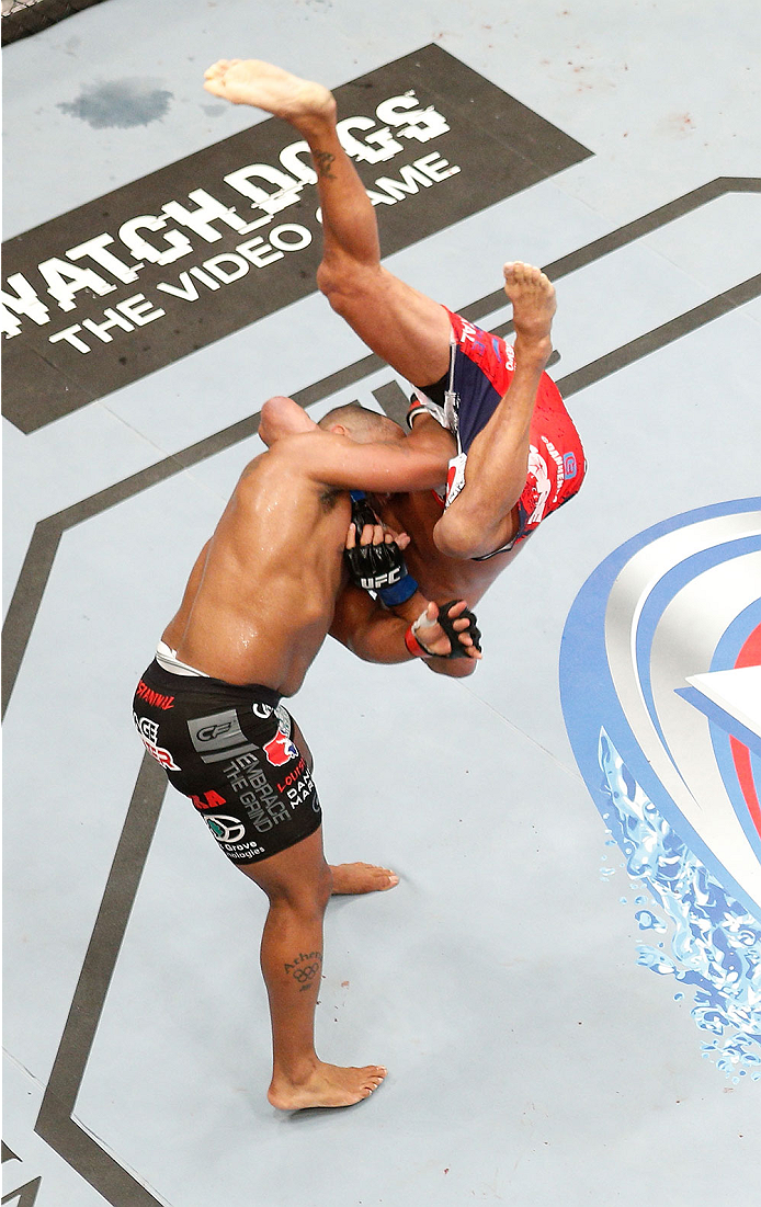 LAS VEGAS, NV - MAY 24:  An overhead view of the Octagon as Daniel Cormier (black trunks) slams Dan Henderson during the UFC 173 event at the MGM Grand Garden Arena on May 24, 2014 in Las Vegas, Nevada. (Photo by Josh Hedges/Zuffa LLC/Zuffa LLC via Getty Images)