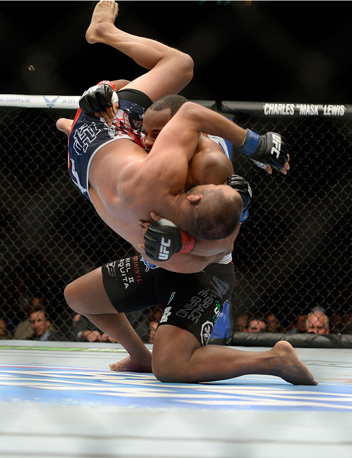 LAS VEGAS, NV - MAY 24: (R-L) Daniel Cormier throws down Dan Henderson in their light heavyweight bout during the UFC 173 event at the MGM Grand Garden Arena on May 24, 2014 in Las Vegas, Nevada. (Photo by Jeff Bottari/Zuffa LLC/Zuffa LLC via Getty Images)