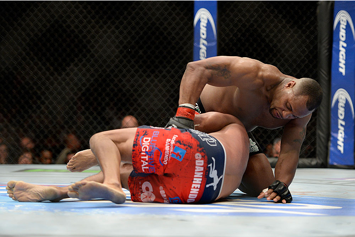 LAS VEGAS, NV - MAY 24: (R-L) Daniel Cormier tpunches and controls the body of Dan Henderson in their light heavyweight bout during the UFC 173 event at the MGM Grand Garden Arena on May 24, 2014 in Las Vegas, Nevada. (Photo by Jeff Bottari/Zuffa LLC/Zuffa LLC via Getty Images)