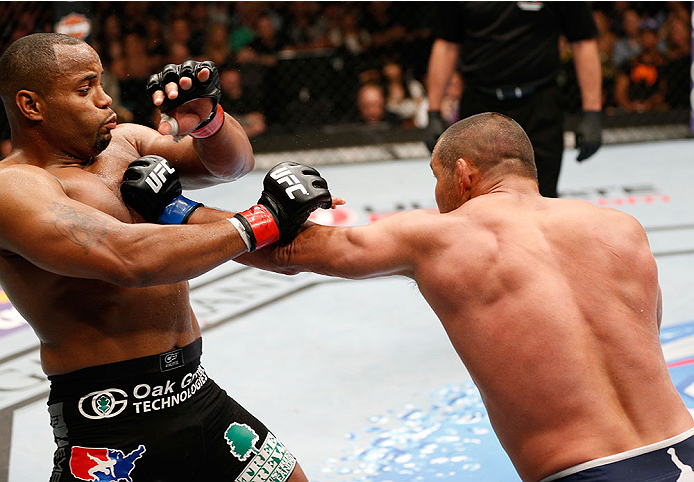 LAS VEGAS, NV - MAY 24:  (R-L) Dan Henderson punches Daniel Cormier in their light heavyweight bout during the UFC 173 event at the MGM Grand Garden Arena on May 24, 2014 in Las Vegas, Nevada. (Photo by Josh Hedges/Zuffa LLC/Zuffa LLC via Getty Images)