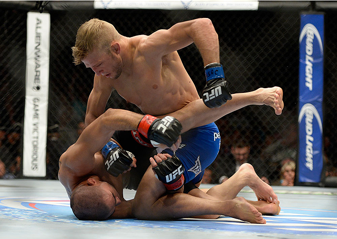 LAS VEGAS, NV - MAY 24:  (R-L) T.J. Dillashaw punches Renan Barao in their bantamweight championship bout during the UFC 173 event at the MGM Grand Garden Arena on May 24, 2014 in Las Vegas, Nevada. (Photo by Jeff Bottari/Zuffa LLC/Zuffa LLC via Getty Images)