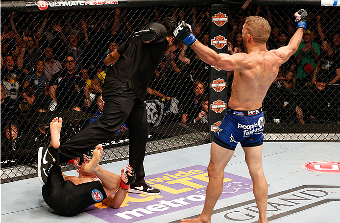 LAS VEGAS, NV - MAY 24:  T.J. Dillashaw (right) reacts to his victory over Renan Barao in their bantamweight championship bout during the UFC 173 event at the MGM Grand Garden Arena on May 24, 2014 in Las Vegas, Nevada. (Photo by Josh Hedges/Zuffa LLC/Zuffa LLC via Getty Images)