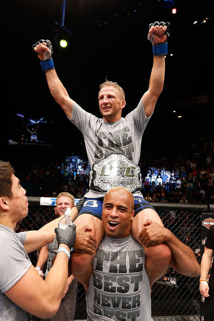 LAS VEGAS, NV - MAY 24:  T.J. Dillashaw (top) celebrates his victory over Renan Barao in their bantamweight championship bout during the UFC 173 event at the MGM Grand Garden Arena on May 24, 2014 in Las Vegas, Nevada. (Photo by Josh Hedges/Zuffa LLC/Zuffa LLC via Getty Images)