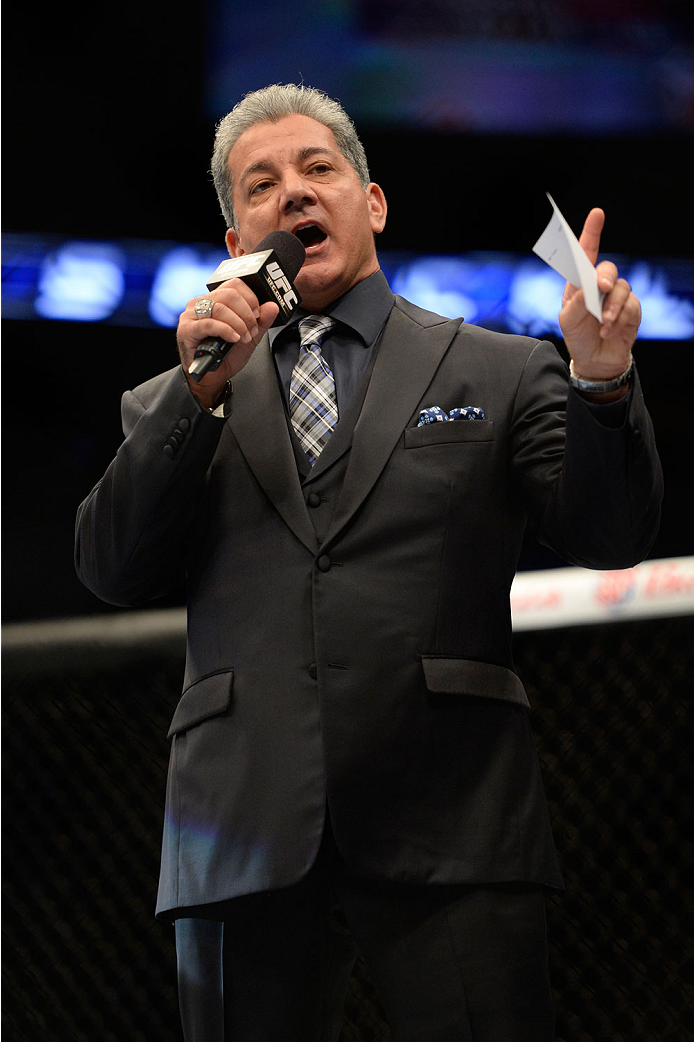 VANCOUVER, BC - JUNE 14:  UFC Octagon Announcer Bruce Buffer introduces Josh Shockley during the UFC 174 event at Rogers Arena on June 14, 2014 in Vancouver, British Columbia, Canada. (Photo by Jeff Bottari/Zuffa LLC/Zuffa LLC via Getty Images)