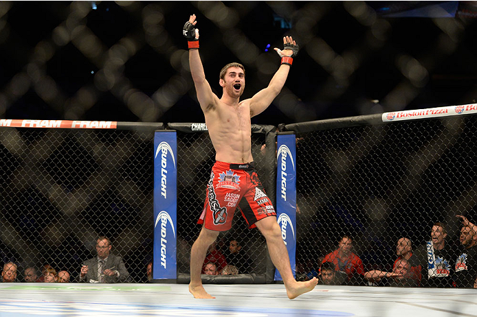 VANCOUVER, BC - JUNE 14:  Jason Saggo celebrates after a defeating Josh Shockley by TKO during the UFC 174 event at Rogers Arena on June 14, 2014 in Vancouver, British Columbia, Canada. (Photo by Jeff Bottari/Zuffa LLC/Zuffa LLC via Getty Images)