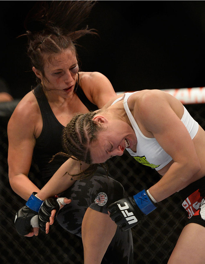 VANCOUVER, BC - JUNE 14:  (L-R) Valerie Latourneau knees the head of Elizabeth Phillips during the UFC 174 event at Rogers Arena on June 14, 2014 in Vancouver, British Columbia, Canada. (Photo by Jeff Bottari/Zuffa LLC/Zuffa LLC via Getty Images)