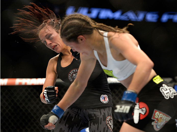 (R-L) Elizabeth Phillips punches Valerie Latourneau during the UFC 174 event at Rogers Arena on June 14, 2014 in Vancouver, British Columbia, Canada. (Photo by Jeff Bottari/Zuffa LLC)