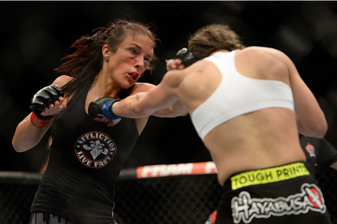 VANCOUVER, BC - JUNE 14:  Valerie Latourneau punches Elizabeth Phillips during the UFC 174 event at Rogers Arena on June 14, 2014 in Vancouver, British Columbia, Canada. (Photo by Jeff Bottari/Zuffa LLC/Zuffa LLC via Getty Images)