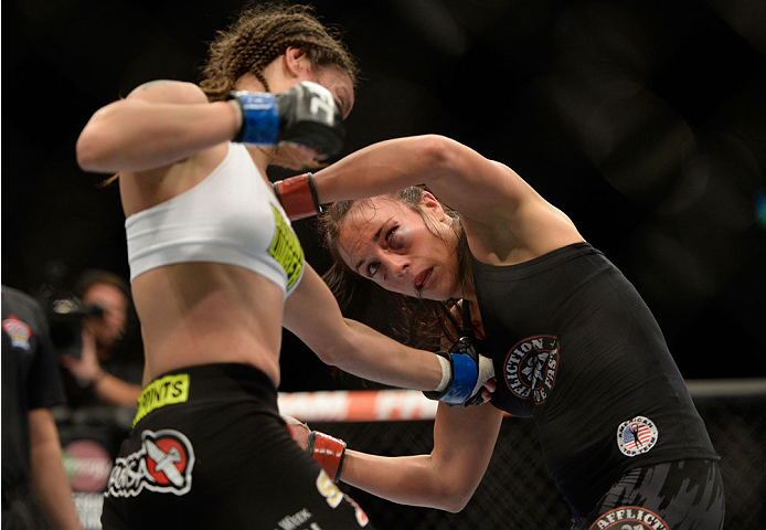 VANCOUVER, BC - JUNE 14:  (L-R) Elizabeth Phillips punches Valerie Latourneau during the UFC 174 event at Rogers Arena on June 14, 2014 in Vancouver, British Columbia, Canada. (Photo by Jeff Bottari/Zuffa LLC/Zuffa LLC via Getty Images)