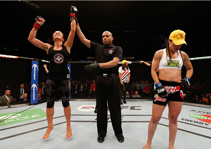 VANCOUVER, BC - JUNE 14:  Valerie Letourneau reacts after her split decision victory over Elizabeth Phillips in their womens bantamweight bout at Rogers Arena on June 14, 2014 in Vancouver, Canada.  (Photo by Josh Hedges/Zuffa LLC/Zuffa LLC via Getty Images)
