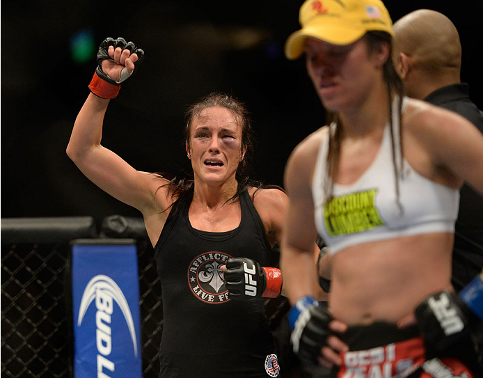 VANCOUVER, BC - JUNE 14:  (L-R) Valerie Latourneau celebrates after a split decision win over Elizabeth Phillips during the UFC 174 event at Rogers Arena on June 14, 2014 in Vancouver, British Columbia, Canada. (Photo by Jeff Bottari/Zuffa LLC/Zuffa LLC via Getty Images)