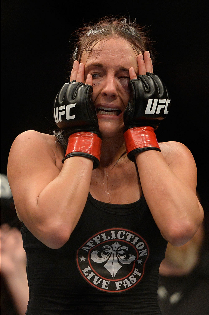 VANCOUVER, BC - JUNE 14:  Valerie Latourneau celebrates after a split decision win over Elizabeth Phillips during the UFC 174 event at Rogers Arena on June 14, 2014 in Vancouver, British Columbia, Canada. (Photo by Jeff Bottari/Zuffa LLC/Zuffa LLC via Getty Images)