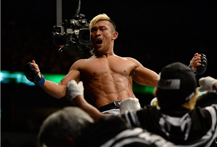 VANCOUVER, BC - JUNE 14:  Kiichi Kunimoto celebrates after defeating Daniel Sarafian by a rear naked choke during the UFC 174 event at Rogers Arena on June 14, 2014 in Vancouver, British Columbia, Canada. (Photo by Jeff Bottari/Zuffa LLC/Zuffa LLC via Getty Images)