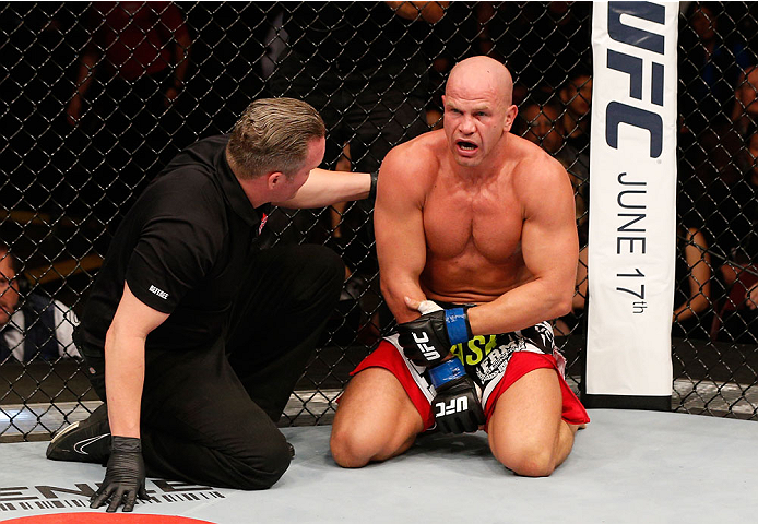 VANCOUVER, BC - JUNE 14:  Ryan Jimmo clutches his arm in pain after his submission loss to Ovince Saint Preux in their light heavyweight bout at Rogers Arena on June 14, 2014 in Vancouver, Canada.  (Photo by Josh Hedges/Zuffa LLC/Zuffa LLC via Getty Images)