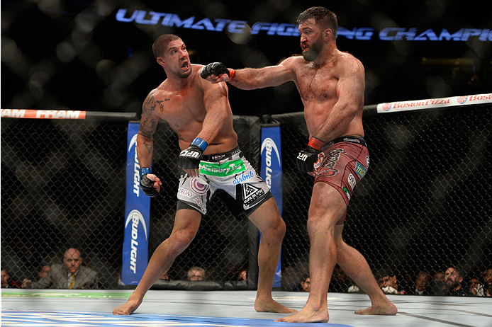 VANCOUVER, BC - JUNE 14:  (L-R) Brendan Schaub and Andrei Arlovski exchange punches during the UFC 174 event at Rogers Arena on June 14, 2014 in Vancouver, British Columbia, Canada. (Photo by Jeff Bottari/Zuffa LLC/Zuffa LLC via Getty Images)