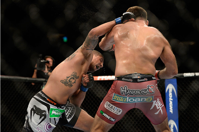 VANCOUVER, BC - JUNE 14:  (L-R) Brendan Schaub punches Andrei Arlovski during the UFC 174 event at Rogers Arena on June 14, 2014 in Vancouver, British Columbia, Canada. (Photo by Jeff Bottari/Zuffa LLC/Zuffa LLC via Getty Images)