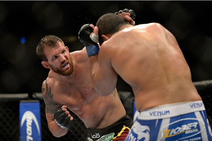 VANCOUVER, BC - JUNE 14:  (L-R) Ryan Bader punches Rafael Cavalcante during the UFC 174 event at Rogers Arena on June 14, 2014 in Vancouver, British Columbia, Canada. (Photo by Jeff Bottari/Zuffa LLC/Zuffa LLC via Getty Images)