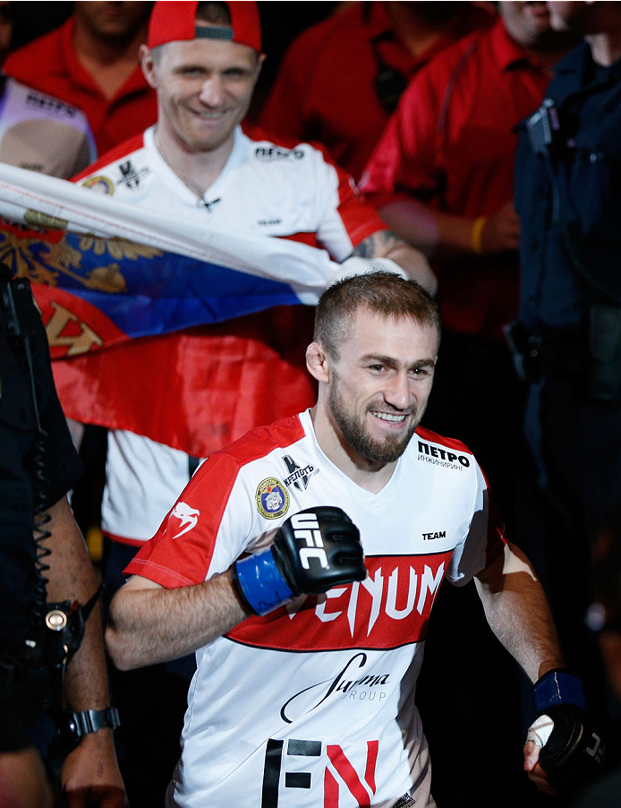 VANCOUVER, BC - JUNE 14:  Ali Bagautinov enters the arena before facing UFC Flyweight Champion Demtrious 'Mighty Mouse' Johnson in their UFC flyweight championship bout at Rogers Arena on June 14, 2014 in Vancouver, Canada.  (Photo by Josh Hedges/Zuffa LLC/Zuffa LLC via Getty Images)