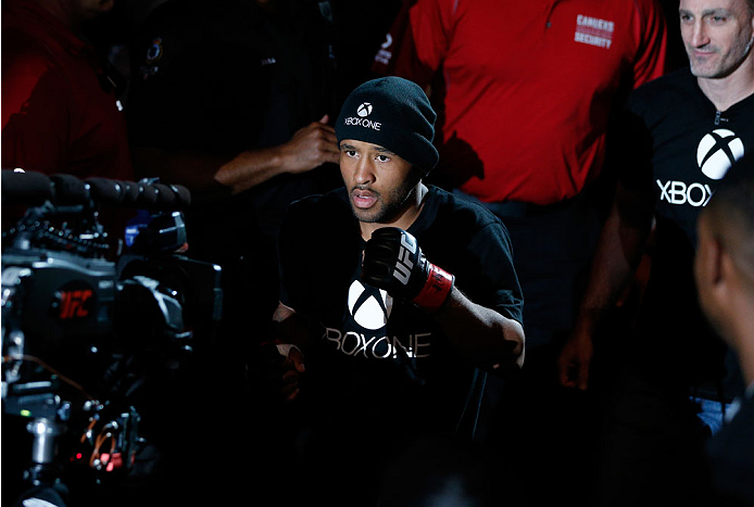 VANCOUVER, BC - JUNE 14:  UFC Flyweight Champion Demetrious 'Mighty Mouse' Johnson enters the arena before facing challenger Ali Bagautinov in their UFC flyweight championship bout at Rogers Arena on June 14, 2014 in Vancouver, Canada.  (Photo by Josh Hedges/Zuffa LLC/Zuffa LLC via Getty Images)