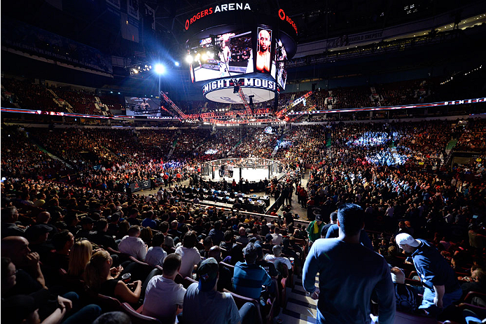 VANCOUVER, BC - JUNE 14:  A general view of Demetrious 'Mighty Mouse' Johnson entering the Octagon before his championship bout against Ali Bagautinov during the UFC 174 event at Rogers Arena on June 14, 2014 in Vancouver, British Columbia, Canada. (Photo by Jeff Bottari/Zuffa LLC/Zuffa LLC via Getty Images)