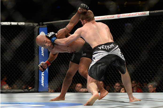 VANCOUVER, BC - JUNE 14:  (L-R) UFC Flyweight Champion Demetrious 'Mighty Mouse' Johnson punches Ali Bagautinov during their flyweight championship bout at the UFC 174 event at Rogers Arena on June 14, 2014 in Vancouver, British Columbia, Canada. (Photo by Jeff Bottari/Zuffa LLC/Zuffa LLC via Getty Images)