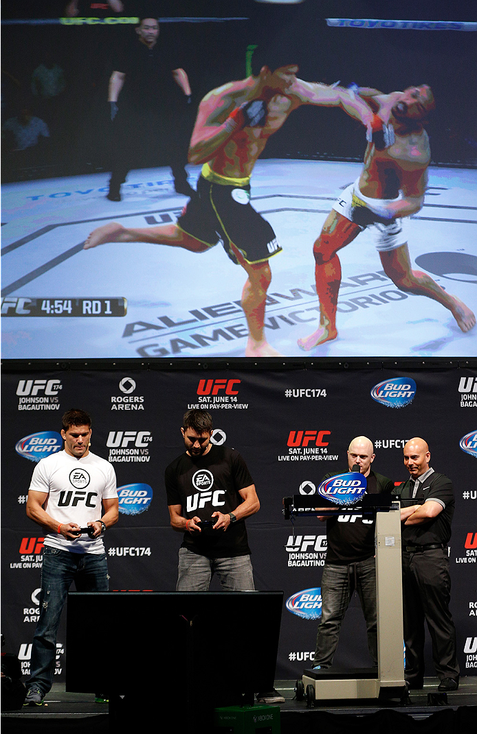 VANCOUVER, BC - JUNE 13:  Josh Thomson and Carlos Condit battle in a demo of the new EA Sports UFC videogame before the UFC 174 weigh-in at Rogers Arena on June 13, 2014 in Vancouver, Canada.  (Photo by Josh Hedges/Zuffa LLC/Zuffa LLC via Getty Images)
