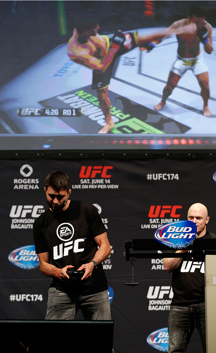 VANCOUVER, BC - JUNE 13:  Carlos Condit battles against Josh Thomson (not pictured) in a demo of the new EA Sports UFC videogame before the UFC 174 weigh-in at Rogers Arena on June 13, 2014 in Vancouver, Canada.  (Photo by Josh Hedges/Zuffa LLC/Zuffa LLC via Getty Images)