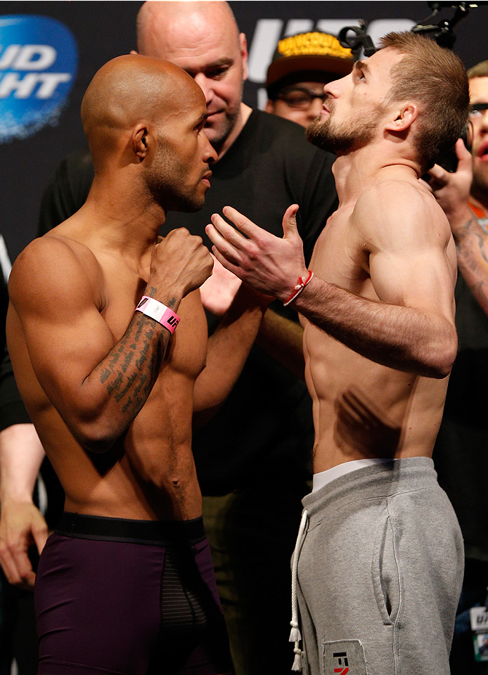 "VANCOUVER, BC - JUNE 13:  (L-R) UFC flyweight champion Demetrious ""Mighty Mouse"" Johnson and challenger Ali Bagautinov face off during the UFC 174 weigh-in at Rogers Arena on June 13, 2014 in Vancouver, Canada.  (Photo by Josh Hedges/Zuffa LLC/Zuffa LLC via Getty Images)"