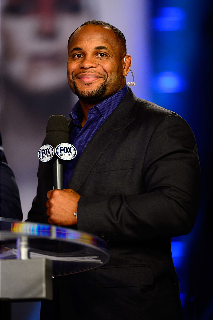 LAS VEGAS, NV - JULY 4:  Mixed martial artist Daniel Cormier smiles on the FOX television desk during the UFC 175 weigh-in inside the Mandalay Bay Events Center on July 4, 2014 in Las Vegas, Nevada. (Photo by Jeff Bottari/Zuffa LLC/Zuffa LLC via Getty Images)