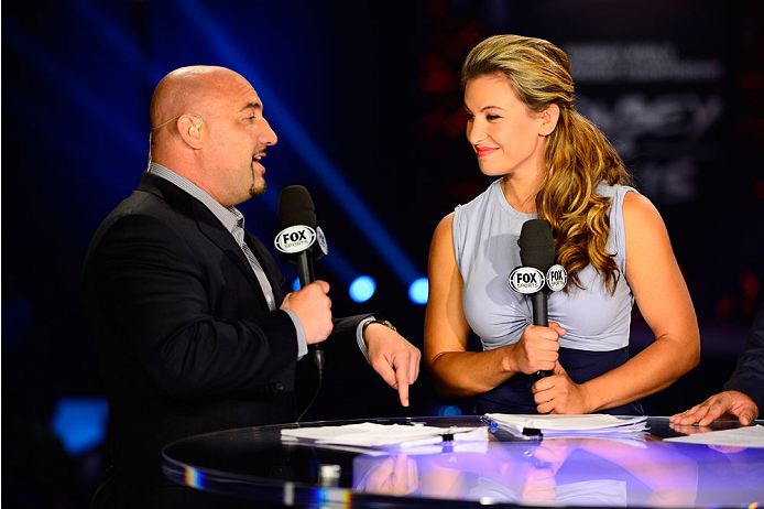 LAS VEGAS, NV - JULY 4:  Sports broadcaster Jay Glazer interacts with mixed martial artist Miesha Tate at the FOX television desk during the UFC 175 weigh-in inside the Mandalay Bay Events Center on July 4, 2014 in Las Vegas, Nevada. (Photo by Jeff Bottari/Zuffa LLC/Zuffa LLC via Getty Images)