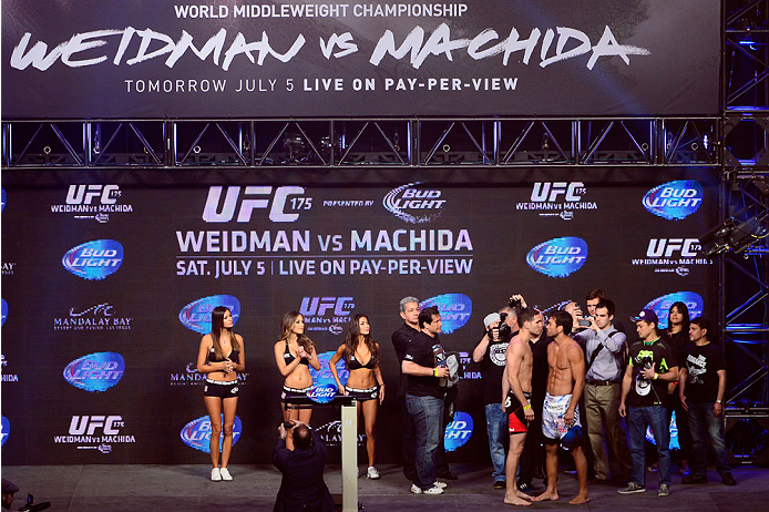 LAS VEGAS, NV - JULY 4:  UFC Middleweight Champion Chris Weidman (L) and challenger Lyoto Machida face off during the UFC 175 weigh-in inside the Mandalay Bay Events Center on July 4, 2014 in Las Vegas, Nevada. (Photo by Jeff Bottari/Zuffa LLC/Zuffa LLC via Getty Images)