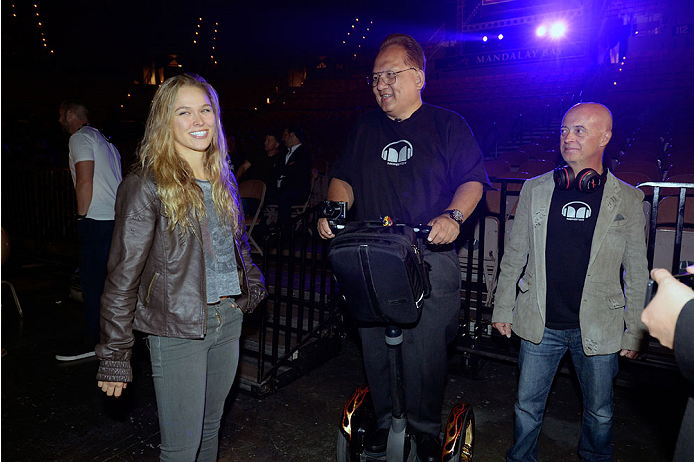 LAS VEGAS, NV - JULY 4:  UFC Women's Bantamweight Champion Ronda Rousey (L) interacts with CEO OF Monster Noel Lee (C) during the UFC 175 weigh-in inside the Mandalay Bay Events Center on July 4, 2014 in Las Vegas, Nevada. (Photo by Jeff Bottari/Zuffa LLC/Zuffa LLC via Getty Images)
