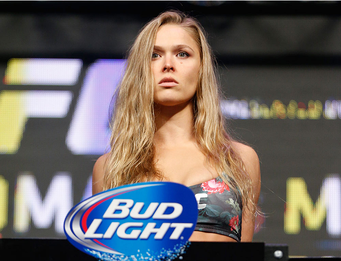 Rousey steps on the scale at UFC 175 weigh-ins