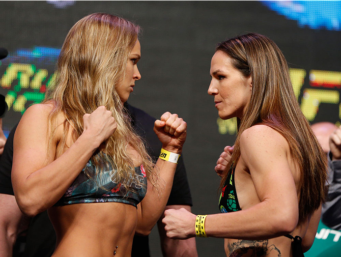 LAS VEGAS, NV - JULY 04:  (L-R) UFC Women's Bantamweight Champion Ronda Rousey faces off with Alexis Davis during the UFC 175 weigh-in inside the Mandalay Bay Events Center on July 4, 2014 in Las Vegas, Nevada.  (Photo by Josh Hedges/Zuffa LLC/Zuffa LLC via Getty Images)