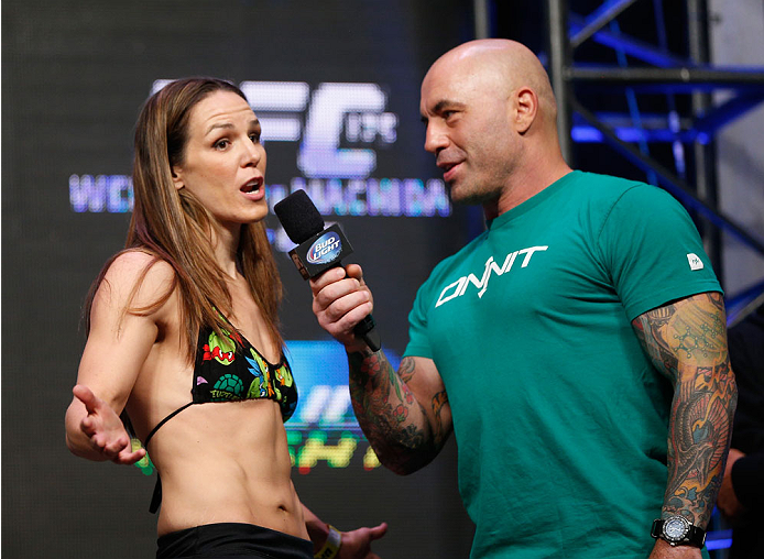 LAS VEGAS, NV - JULY 04:  Alexis Davis talks with Joe Rogan after weighing in during the UFC 175 weigh-in inside the Mandalay Bay Events Center on July 4, 2014 in Las Vegas, Nevada.  (Photo by Josh Hedges/Zuffa LLC/Zuffa LLC via Getty Images)