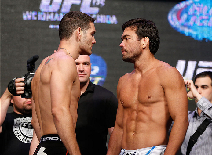 LAS VEGAS, NV - JULY 04:  (L-R) UFC Middleweight Champion Chris Weidman faces off with Lyoto Machida during the UFC 175 weigh-in inside the Mandalay Bay Events Center on July 4, 2014 in Las Vegas, Nevada.  (Photo by Josh Hedges/Zuffa LLC/Zuffa LLC via Getty Images)
