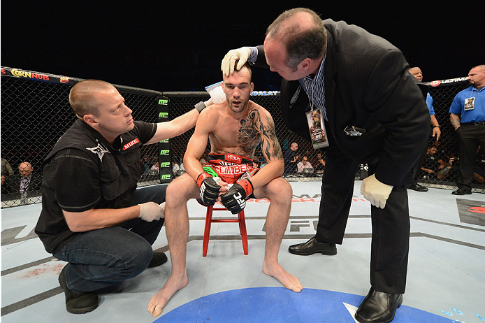 LAS VEGAS, NV - JULY 05:  George Roop recovers after being defeated by Rob Font in their bantamweight fight at UFC 175 inside the Mandalay Bay Events Center on July 5, 2014 in Las Vegas, Nevada.  (Photo by Donald Miralle/Zuffa LLC/Zuffa LLC via Getty Images)
