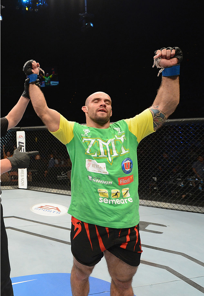 LAS VEGAS, NV - JULY 05:  Bruno Santos celebrates after defeating Chris Camozzi in their middleweight fight at UFC 175 inside the Mandalay Bay Events Center on July 5, 2014 in Las Vegas, Nevada.  (Photo by Donald Miralle/Zuffa LLC/Zuffa LLC via Getty Images)