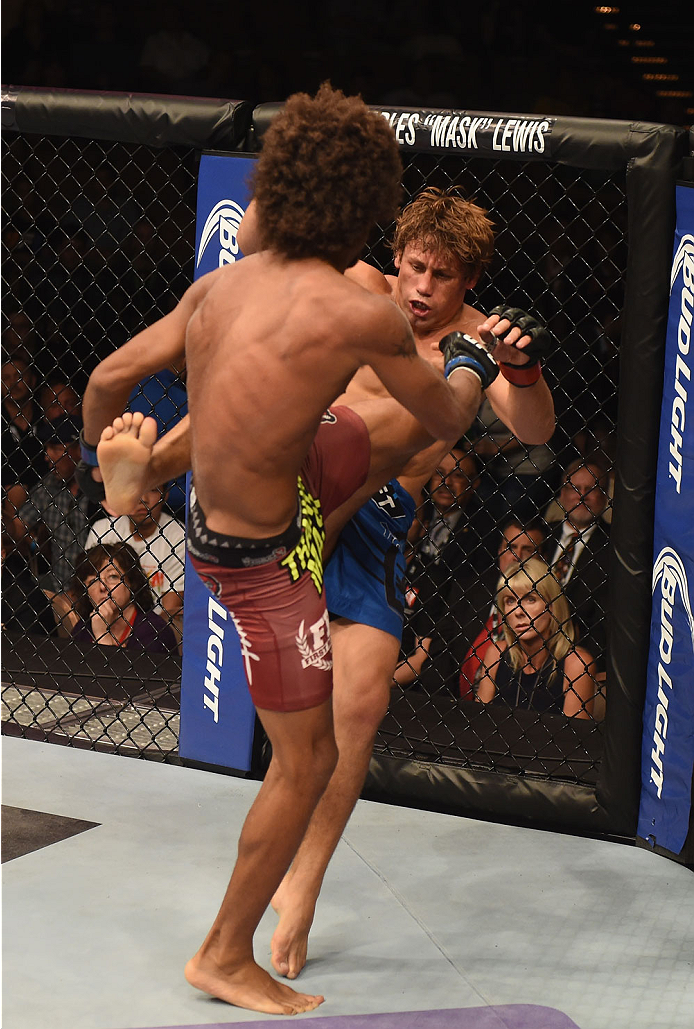 LAS VEGAS, NV - JULY 05:  (L-R) Alex Caceres and Urijah Faber exchange kicks in their bantamweight fight at UFC 175 inside the Mandalay Bay Events Center on July 5, 2014 in Las Vegas, Nevada.  (Photo by Donald Miralle/Zuffa LLC/Zuffa LLC via Getty Images)