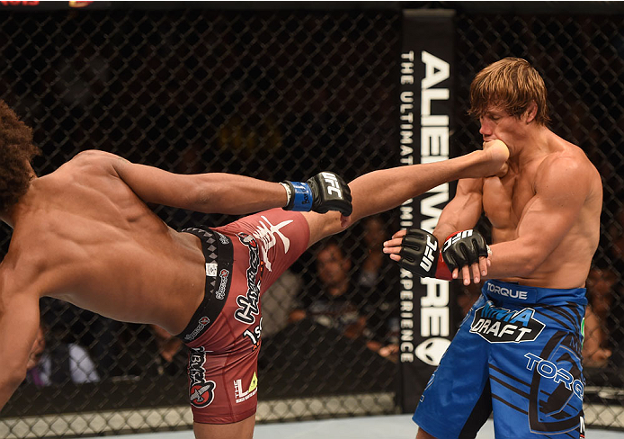 Caceres lands a kick against Faber