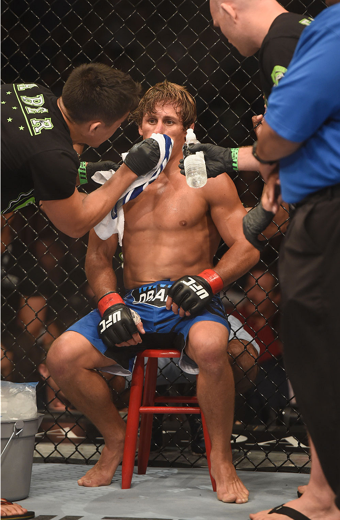 LAS VEGAS, NV - JULY 05:  Urijah Faber recovers in his corner between rounds during his fight with Alex Caceres in their bantamweight fight at UFC 175 inside the Mandalay Bay Events Center on July 5, 2014 in Las Vegas, Nevada.  (Photo by Donald Miralle/Zuffa LLC/Zuffa LLC via Getty Images)